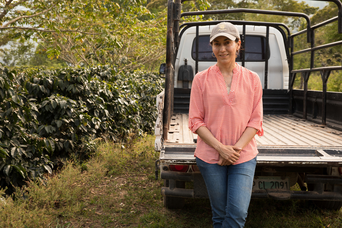 Coffee farmer standing next to truck
