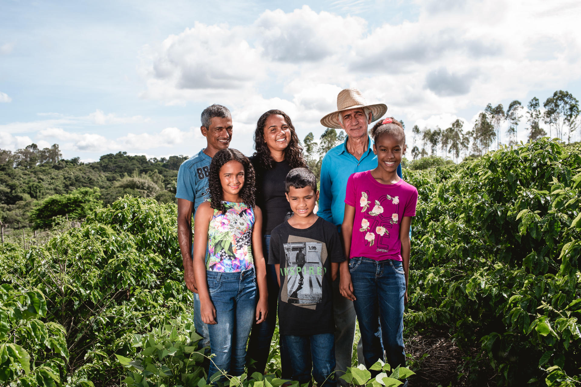 Farmer Family standing in coffee field