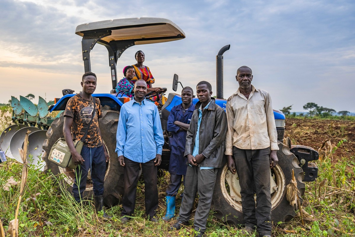 coffee farmers in Uganda in front of their tractor