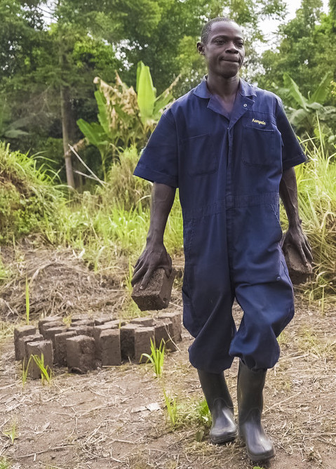 Ivan carrying mulch