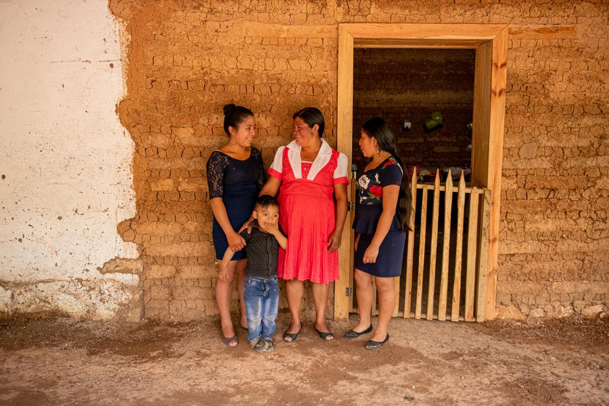 woman coffee farmers with kid in guatemala